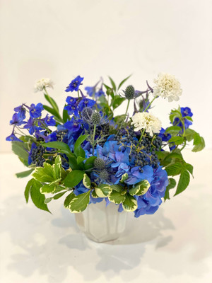 Birth Month Floral - SEPTEMBER September's gemstone is the Sapphire. Our blue toned floral is made up of hydrangea, delphinium, thistle, and accented with white scabiosa. Lush greenery surrounds these flowers which will include navy blue privet berry when it comes available throughout the month of September.Inspiration for this floral comes from the birthstone that coincides with the month your birthday is in. There is a bit of a traditional vs. modern birthstone calendar out there so we've decided to err on the more modern side. We pull in colors of flowers and greenery (and sometimes the vase) to coincide with the colors of the months birthstone.