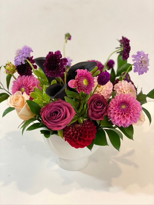 Chalkboard Floral These fun colors feel like a bright chalk drawing! Seasonal flowers are joined together with their bright colors and fun shapes! Dahlias and dancing scabiosa are some of the fun items we'll use.Seattle flower delivery by Juniper Flowers