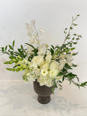October + Opals in October Birth Month White hydrangea, callas, snapdragons, and roses are wonderful expressions of elegance, elevated in a modern metallic toned vase. Accented with dried lunaria for it's opalescence, this floral appeals to lovers of the October gemstone! Seattle flower delivery by Juniper Flowers
