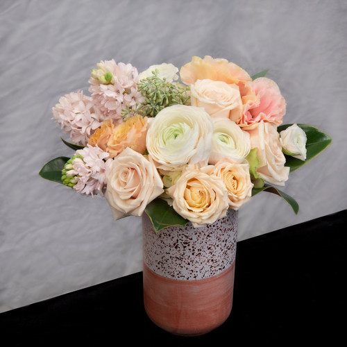 Blush tones of roses, lisianthus, hyacinth and local blooms