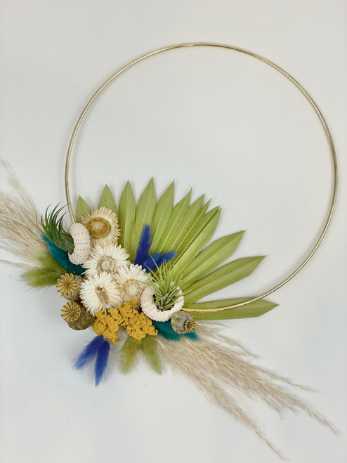 gold hoop with everlasting dried florals in tones of sage, teal, navy, camel and cream