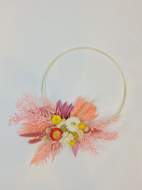 gold hoop with everlasting dried florals in tones of blush, pink, coral and cream with a hint of gray