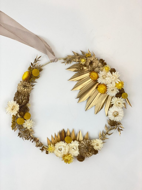 gold hoop with everlasting dried florals in tones of beige, cream, and gold