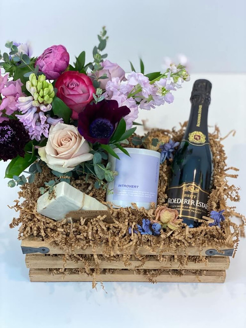 Essentials Gift Crate with desktop floral, handmade soap bar, fragrant candle, wine and dried flower blooms for Seattle flower delivery by Juniper Flowers
