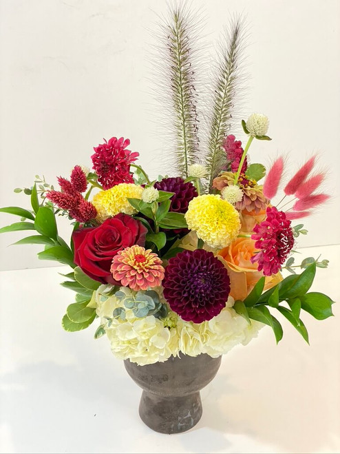 Farewell Summer This dark toned vase is filled with hydrangea, dahlias, roses and fun bunny tail. Say goodbye to summer with this gem of a floral! Seattle Flower delivery by Juniper Flowers