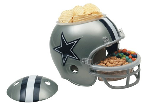 """These helmet snack bowls are perfect for game day parties! It has many great uses: ice bucket, chips & dip, candy dish, cookie jar, relish tray, even a planter! This is a great gift idea for yourself or your favorite sports fan. The helmet itself is about 9"""" tall. The snack bowl includes a removable plastic compartment that fits inside the top of the helmet & a removable divided dish that fits into the faceguard. Both are dishwasher & microwave safe. Made By Wincraft, Inc."""