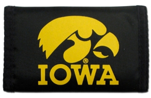 """This officially licensed durable nylon wallet features vibrant team colors and logos. It has a compartment for money, 3 sewn in pockets and a plastic photo/credit card holder. The velcro closure keeps everything securely inside. Measures approximately 5""""x3"""" in size. Made By Rico Industries."""