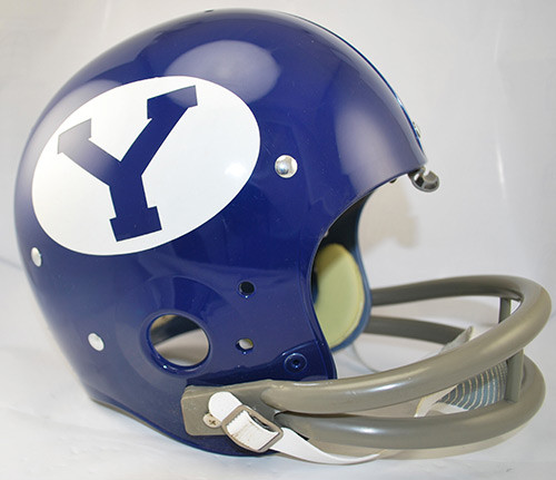 These helmets are slightly smaller than the Collegiate Authentic helmet. This deluxe helmet comes with decorative internal padding, a polyvinyl-coated steel facemask and a 2-point chin strap. This is perfect for a display piece! Made By Riddell.