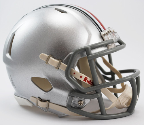 "The Speed Mini Helmet is a half scale replica of one of the most popular new helmet introductions in Riddell's history. It's a must have for the serious collector. Includes interior padding and a 4-point chinstrap. Official colors and decals. Ideal for autographs. Approximately 5"" tall. Made By Riddell"