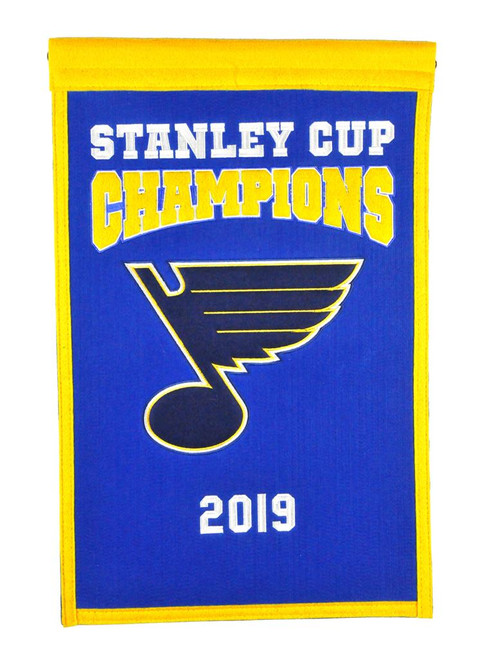 Celebrate the Blues historic Stanley Cup with this banner. The banner is constructed with applique and embroidery detail on a heavy wool blend fabric, providing a vintage feel and look. Measures approximately 14x22 inches and includes a hanging cord for easy display. Made By Winning Streak Sports.