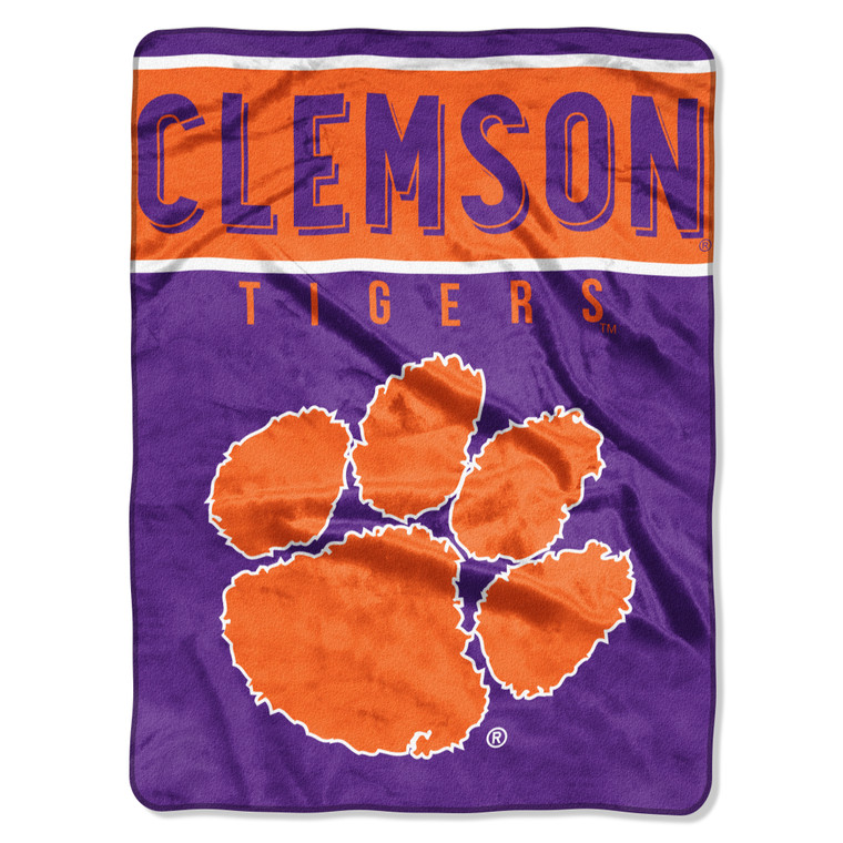 """This is the softest, brightest, and plushest printed blanket on the planet! This luxurious throw can be used at the game, on a picnic, in the bedroom, or cuddle under it in the den while watching the game. These blankets are extra warm and have superior durability. They are easy to care for, and are machine washable and dryable. The throw blanket is made of acrylic and polyester, and is 60""""x80"""" in size. Made By Northwest Company."""