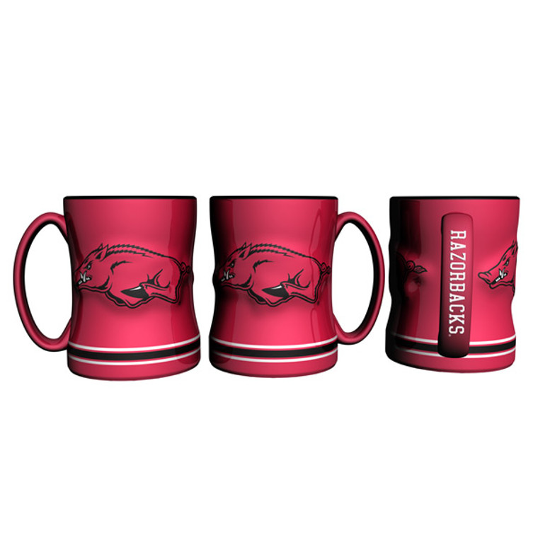 "The sculpted coffee mug is decorated with your teams bright and colorful graphics. The team logo is on both sides, and is slightly raised. The mug also features the teams name on the handle and is made of ceramic. It holds 14 ounces of fluid and is microwave and dishwasher safe. Approximately 4.5"" tall. Made By Boelter Brands"
