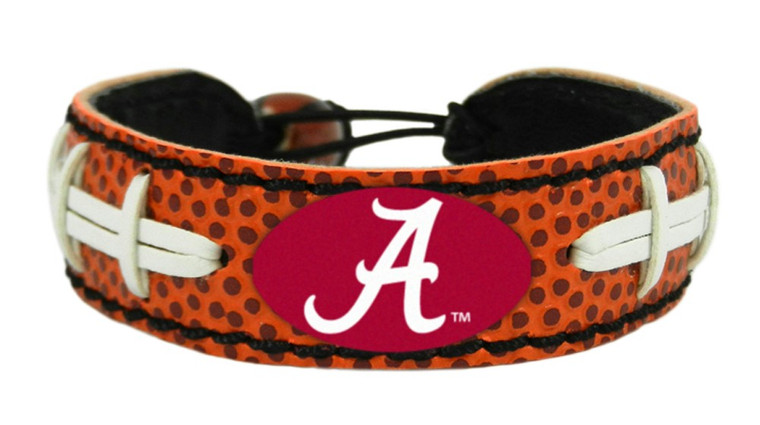 Support your team by wearing a classic team  bracelet! This handmade bracelet is made of genuine leather. The bracelet also features a ceramic bead and elastic loops for closure. There are two loops for adjustable sizing, making sure your bracelet is secure. One size fits all, and will fit most children and adults. Not recommended for children under 5. Made By Gamewear