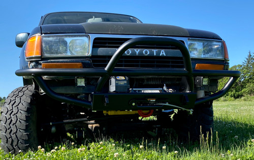Picture shows powder coated bumper with lights and winch as an example. Bumper for sale comes raw without winch and lights.
