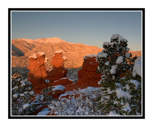 Pikes Peak over Siamese Twins Covered in Snow in Garden of the Gods in Colorado Springs, Colorado 2415