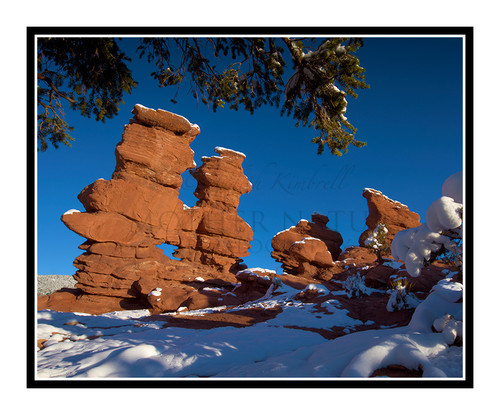 Siamese Twins Covered in Snow in Garden of the Gods in Colorado Springs, Colorado 2423