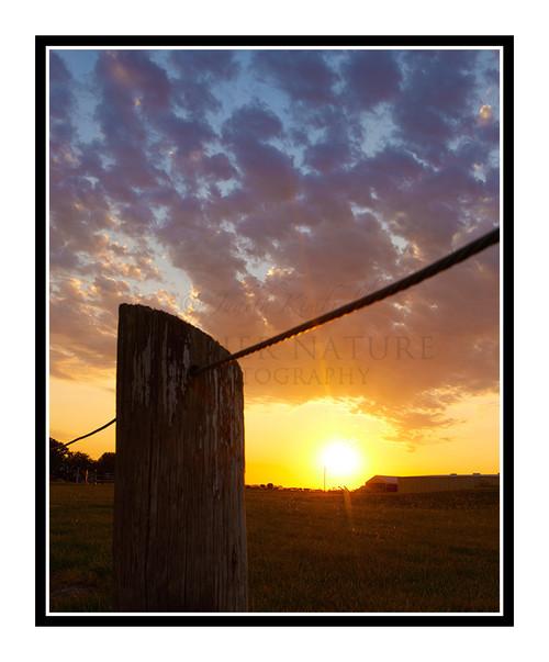 A Vibrant Sunset Beyond a Fence in Salina, Kansas 2670