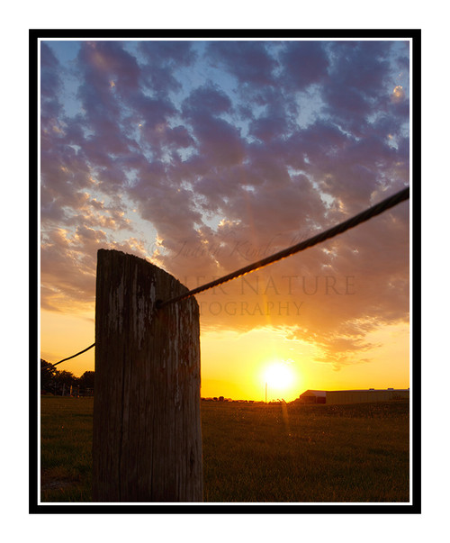 A Vibrant Sunset Beyond a Fence in Salina, Kansas 2670