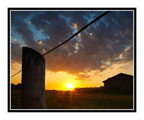 A Vibrant Sunset Beyond a Fence in Salina, Kansas 2671