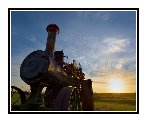 Sunrise Beyond an Antique Tractor in Salina, Kansas 2676