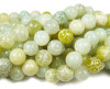 11mm  Antiqued carved jade round beads