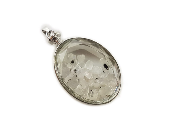 32x42mm Rutilated quartz chips in oval glass pendant