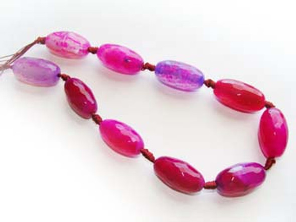 14x27mm  Dark pink Agate faceted rice beads. 10 beads per strand.