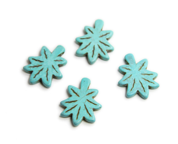 30x24mm  pack of 4 Turquoise howlite carved palm leaf beads