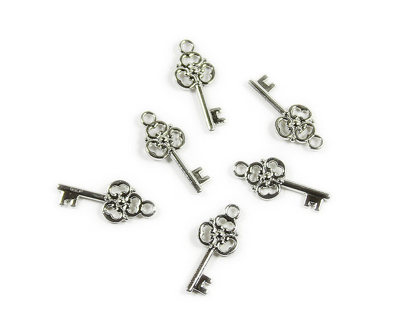 10x24mm  pack of 10 Bali style silver pewter mortice key charm