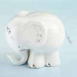"Little Peanut Elephant Porcelain Bank While it may be too early to start thinking about your little peanut's retirement fund, who says you can't find functional unisex baby gifts that will also look adorable in baby's nursery? Baby Aspen's Little Peanut Elephant Porcelain Bank is just the thing. Place on a side table or anywhere in your little one's nursery and it will look just darling.  Features and facts:  White Porcelain elephant-shaped bank is adorned with silver foil detailing. Bank features a removable stopper for easy access to coins. 100% Porcelain bank is hand-wash only Measures 5.7"" w x 6.3"" h x 7.3"" d"