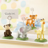 """""""Born To Be Wild"""" Animal Place Card/Photo Holder - Assorted (Set of 4)  When you walk on the wild side, don't be surprised if you come face to face with jungle babies so sweet, they make your heart melt as quickly as the Serengeti sun! Invite four of the sweetest Kate Aspen place card/photo holders ever to your swingin' baby shower--and watch them become the life of the party!  Features and facts:  Four colorful, resin baby jungle animals--a giraffe, an elephant, a tiger and a monkey--on green pedestals with metal place card/photo holder. Sizes vary--giraffe is approximately 3 1/2"""" h x 1 1/2"""" in diameter Monkey is 3"""" h (to top of metal place card/photo holder) x 1 1/2"""" in diameter. Place cards included. Sold in assorted sets of 4."""