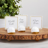"""Geometric Place Card Holder (Set of 6)  Kate Aspen's Geometric Place Card Holder makes the perfect table place card holder for your wedding or special event.  This set of 6 place card holders with their facets and gold detail will wow every guest and match every event theme while adding a touch of elegance to your special event.  These seat assignment organizers will help your guest find their seats in style.  Features and Facts:  Faceted shaped plaster place card holders with gold detail at base. Sold in set of 6. Place cards included. Place card holder measures 1.5"""" w x 1.4"""" h x 1.5"""" d. Place card measures 2.4"""" w x 2.4"""" h. Packaged product measures 5.3"""" w x 3.2"""" h x 1.7"""" d."""
