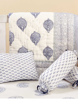 """5 Pc Crib Quilt Set - Perfect Newborn Gift  • Set of 5 includes: 1 reversible quilt, 1 super soft fitted crib sheet, 1 quilted pillow cover and (hypoallergenic polyester filler) and 2 bolster pillow covers (with hypoallergenic polyester filler)  • Made from the most luxurious cotton voile and elegantly packaged in ourexclusive muslin bags that are reusable for years to come!  • Quilt Size: L50"""" x W38""""; Fitted Crib Sheet: L52"""" x W28""""x 8""""; Pillow: L12"""" x W9""""; Bolster: W6.5""""x L16"""" (Comes with the covers and actual cushions in a set)  • Wash Care: Machine wash cold- Delicate cycle; Hang dry  Handmade in India: Due to the handmade nature of this product, variances may occur in color and design, making each piece simply unique."""