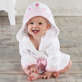 """""""Little Princess"""" Hooded Spa Robe (Personalization Available)  Treat your little princess to a relaxing day at the spa. Baby Aspen's adorably detailed """"Little Princess"""" Hooded Spa Robe features a pretty princess crown applique on the hood. From crown to glass slipper, this sweet gift will keep baby girl snuggly soft and toasty warm after a dip in her royal bath.  Features and facts:  Soft white hooded terrycloth robe featuring pretty organza-trimmed sleeves, a precious princess crown applique on the hood, tied with a princess pink satin ribbon Machine-washable Size 0-9 months Robe measures 22"""" h x 11"""" w  Please note: All personalized items require 5 to 7 business days for processing. If item has personalized tags and stickers, these arrive unattached and require assembly."""