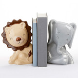 """Safari Porcelain Bookends  We're not """"lion"""" when we tell you that this is one of the most unique baby shower gifts around! Perfect for perching atop a shelf in any animal themed nursery, this pair of Safari Porcelain Bookends will watch over baby's first books all day and night.  Features and facts:  Set of two bookends feature two safari animals sitting: a beige lion with a brown mane and tail tip and a grey elephant with white toes on the hooves and a white tail tip. Bookends are porcelain. Lion bookend measures 5.4"""" w x 4.4"""" d x 7.7"""" h; elephant bookend measures 4.9"""" w x 5.3"""" d x 7.8"""" h"""