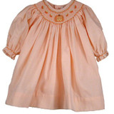 Halloween Pumpkin Dress  This adorable 55% cotton/ 45% polyester two piece set features an orange and white striped woven pique float dress with detailed Halloween pumpkin bishop smocking.  70 cm  Includes a matching bloomer.