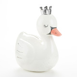 "Swan Princess Porcelain Bank Give the gift of a strong financial foundation with the Swan Princess Porcelain Coin Bank. This functional piggy bank can also serve as a pretty nursery decoration. It's the perfect elegant gift for your next baby shower!  Features and Facts:  White swan shaped porcelain bank has silver foil details in the wings, a dark gray swan mask around the orange beak, and a silver foil crown on her head Bank is surface wash only Bank measures 4.75"" w x 8.5"" h x 5.75"" d Packaged gift measures 7.48"" w x 10.03"" h x 6.1"" d Hand painted porcelain"