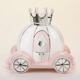 """Little Princess"" Carriage Porcelain Bank Even little princesses need help saving for their future sometimes! Baby Aspen's ""Little Princess"" Porcelain Carriage Bank is a carriage-shaped coin bank where baby girl can put her most treasured items.  Features and facts:  100% surface-washable Porcelain carriage-shaped bank is white with pink and silver detailing. The carriage window is detailed with pink curtains and a raised 3-D silver heart. The carriage also features silver wheels, silver crown, and pink and white korker ribbon detail Measures 8.6"" h x 6.1"" w x 8.3"" d"