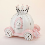 """""""Little Princess"""" Carriage Porcelain Bank Even little princesses need help saving for their future sometimes! Baby Aspen's """"Little Princess"""" Porcelain Carriage Bank is a carriage-shaped coin bank where baby girl can put her most treasured items.  Features and facts:  100% surface-washable Porcelain carriage-shaped bank is white with pink and silver detailing. The carriage window is detailed with pink curtains and a raised 3-D silver heart. The carriage also features silver wheels, silver crown, and pink and white korker ribbon detail Measures 8.6"""" h x 6.1"""" w x 8.3"""" d"""