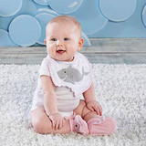 """""""Chomp & Stomp"""" Shark Bib & Booties Gift Set (Pink) Sink your teeth into Baby Aspen's newest bib and bootie gift set. Baby Aspen's Shark Chomp and Stomp now comes in pink to keep your little jaw-dropping baby girl clean and snuggly at mealtime. This fun set includes a white bib with soft pink trim and a grey shark applique in the center and cozy pink booties. The bib features a shark bite cutout and the booties are complete with little shark teeth.  Features and facts:  Ocean-themed design, white bib with appliqued grey shark, embroidered accents, pink and white striped trim and cut-out shark bite; booties have appliqued eyes and felt teeth Velcro closure Bib and Booties are 100% cotton Gift presentation includes pink and white striped box with grosgrain ribbon handle Size 0-9 months"""