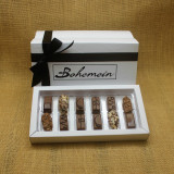 Bohemein 12 Milk Chocolates Gift Box includes: Chocolate Caramel x 2, Amaretto Truffle x 2, Cointreau Ganache x 2, Vanilla Cream - Milk x 2  Maple Cream x 2, Coffee Truffle x 2