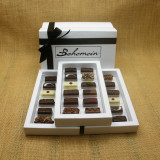 Bohemein Gift Box with 36 Non Alcohol Flavoured Chocolates including: Seventy Truffle x3, Vanilla Cream - Dark x3, Noisette (Hazelnut) x3, Strawberry Ganache x3 ,Pineapple Black Pepper Ganache x3, Ginger Caramel x3, Maple Cream x3, Raspberry Ganache x3, Chocolate Caramel x3, Pistachio Marzipan x3, Coconut Cream Truffle x3, Balsamic Vinegar and Honey Ganache x3