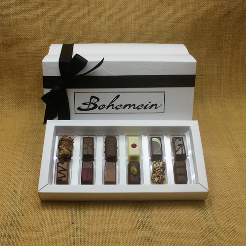 Bohemein Gift Box with 12 Non Alcohol Flavoured Chocolates including: Seventy Truffle, Vanilla Cream - Dark, Noisette (Hazelnut), Strawberry Ganache ,Pineapple Black Pepper Ganache, Ginger Caramel, Maple Cream, Raspberry Ganache, Chocolate Caramel, Pistachio Marzipan, Coconut Cream Truffle, Balsamic Vinegar and Honey Ganache