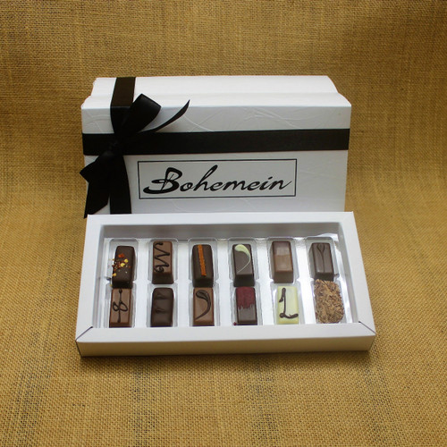 Bohemein Gift Box with 12 Nut Free Chocolates including: Chilli Ganache, Maple Cream, Rosemary and Apricot Ganache, Pineapple and Black Pepper Ganache, Chocolate Caramel, Melting Passion Ganache, Vanilla Cream - Milk, Balsamic Vinegar and Honey Ganache, Cointreau Ganache, Raspberry Ganache, Lemon and Thyme Ganache, Coffee Truffle