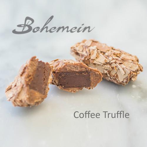 Bohemein Seventy Truffle. 70% dark chocolate ganache dipped in more 70% dark chocolate. Rolled in dark chocolate shavings - a dark chocolate lover's treat.