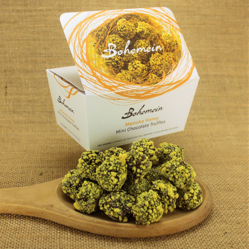 Bohemein Manuka Honey Mini Chocolate Truffle is Arataki Manuka honey and milk chocolate ganache. Coated in dark 53% chocolate and rolled in yellow white chocolate sprinkles.