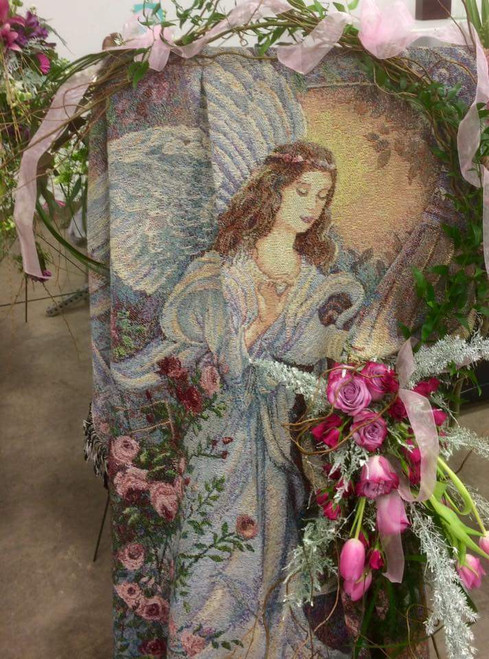 Displayed on an easel with bow, for the funeral home, they are priced at $69.99. Fresh or silk flowers can be added to the display, priced from $110.* to $165.* Sample Shown