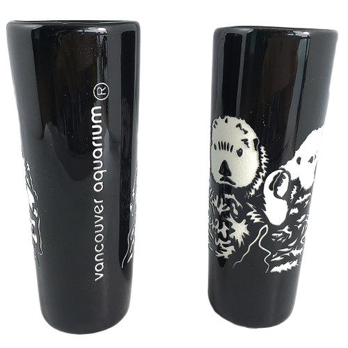 Black shot glass with etched picture of 2 otters
