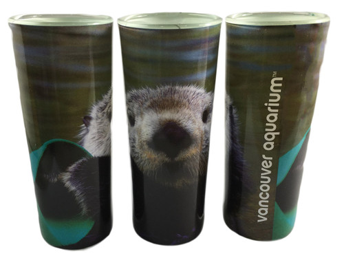 Shot glass with photo of sea otter holding kelp