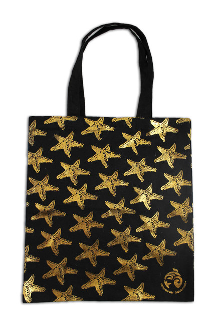 Gold sea star on black tote bag.